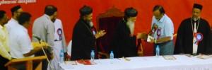 CATHOLICOS PRESENTS THANAL CHARITY AWARD TO DR VP GANGADHARAN